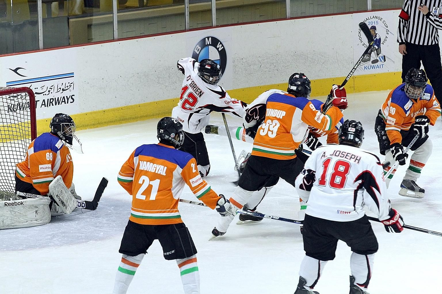 Despite the challenges of training and funding, the Singapore men's ice hockey team (in white) managed a 2nd-place finish in the International Ice Hockey Federation Challenge Cup of Asia in Kuwait in March.