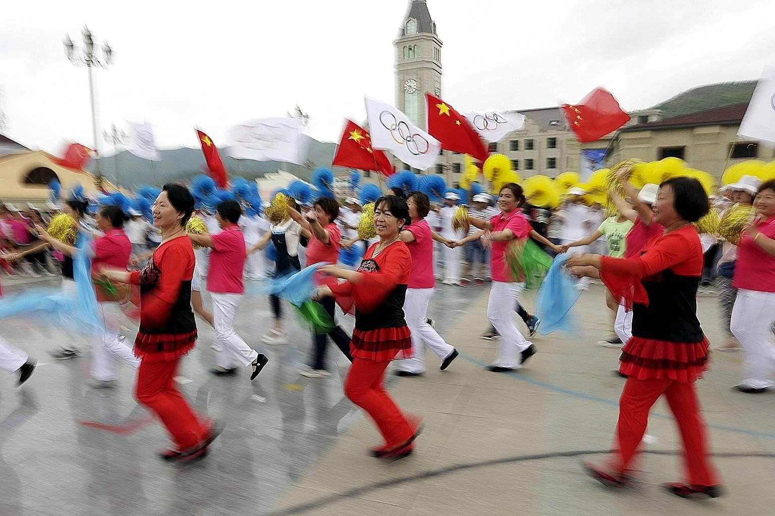 Local residents dance during a rehearsal for a possible celebration today at a square in Chongli county, administered by Zhangjiakou, which is jointly bidding with the capital Beijing to host the 2022 Winter Olympic Games. Beijing, which hosted the 2