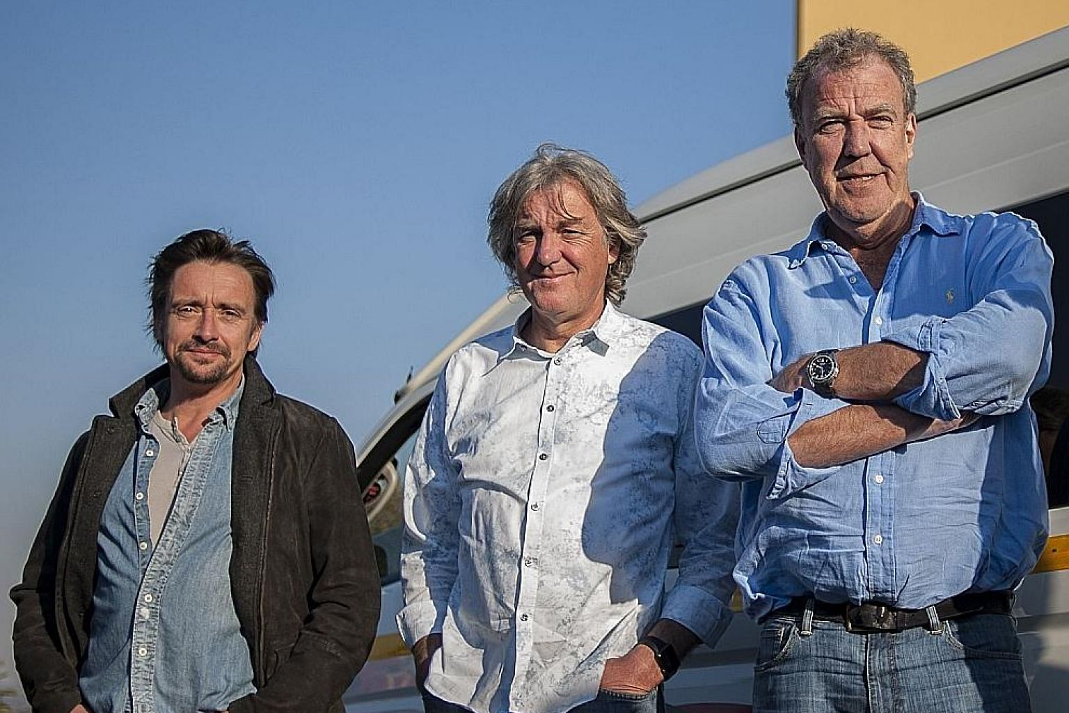 Former Top Gear host Jeremy Clarkson (left) will be hosting a new show for Amazon's subscription service with former co-hosts Richard Hammond (far left) and James May (centre).