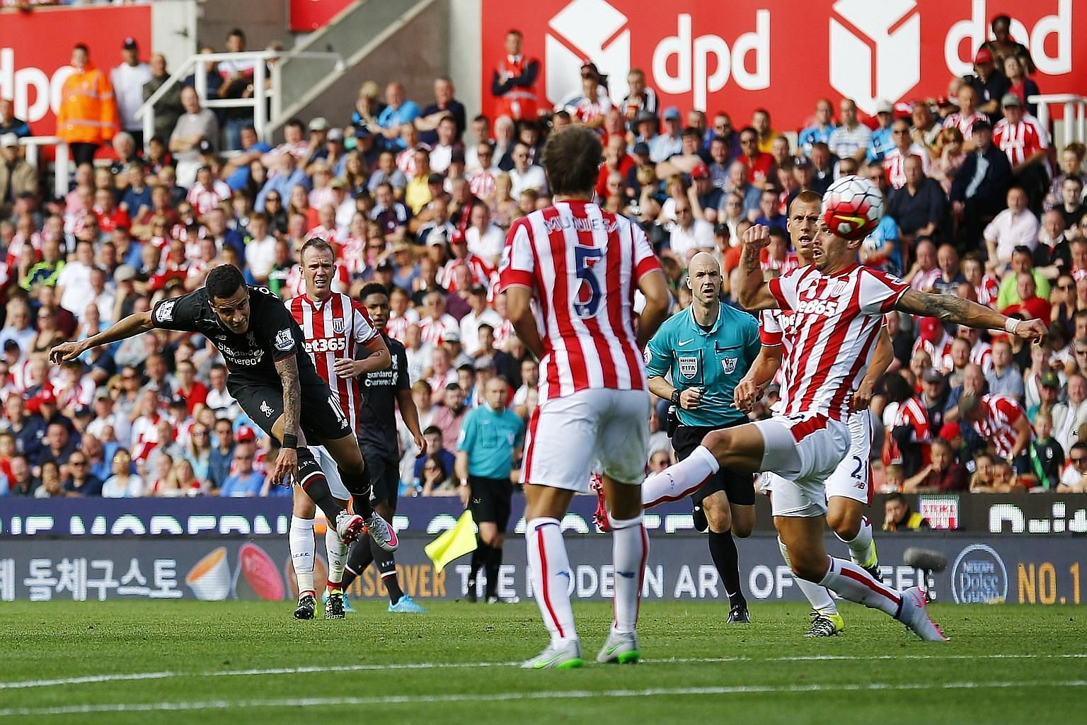 Philippe Coutinho scoring the game's only goal - turning and then taking a shot that curled and dipped beyond Jack Butland (not in picture) in the Stoke goal.