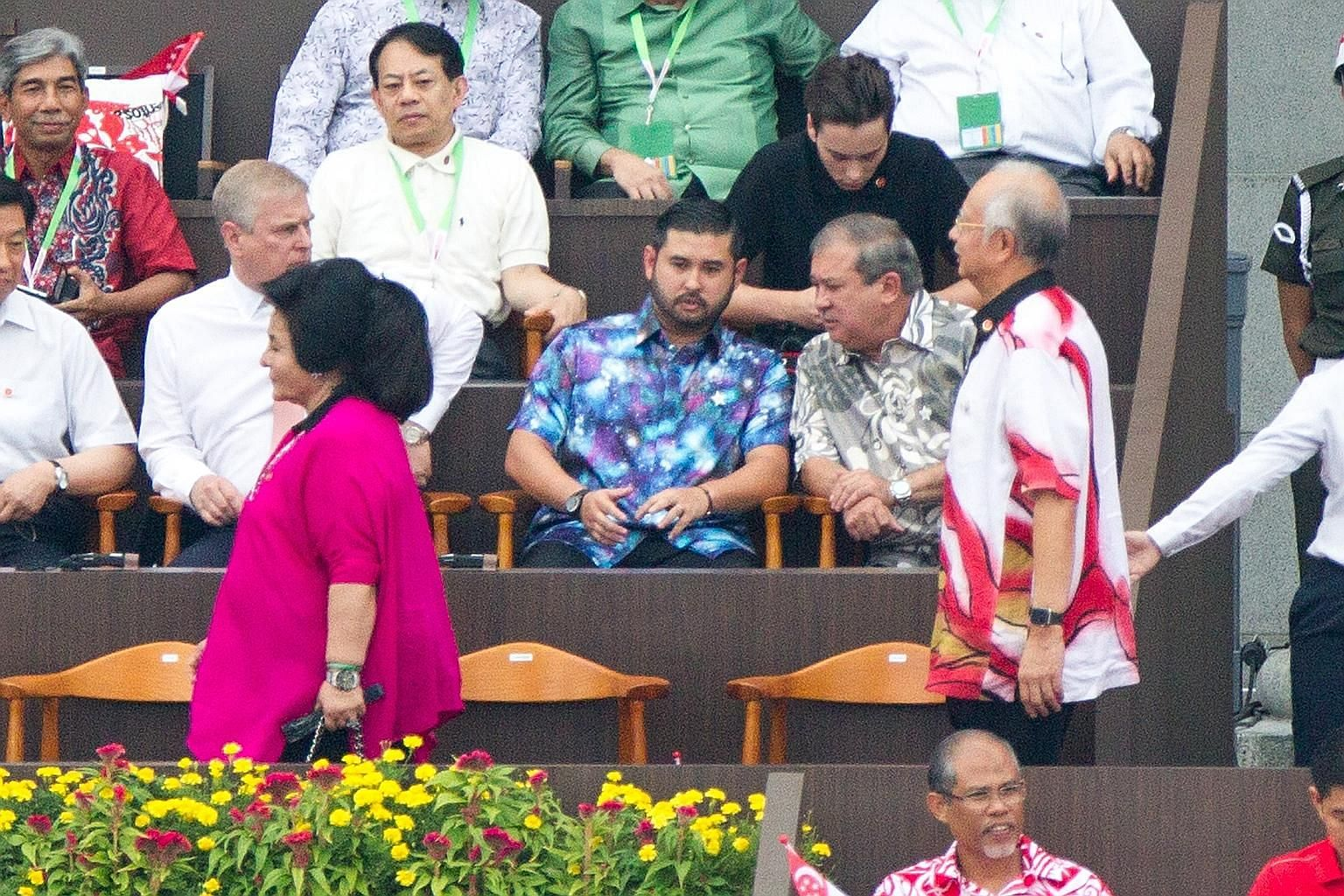 A photo showing Mr Najib (right) walking behind his wife Rosmah at Singapore's National Day celebration on Sunday. Seated on the right of the front row are Johor Sultan Ibrahim Ismail and Johor Crown Prince Tunku Ismail Sultan Ibrahim.