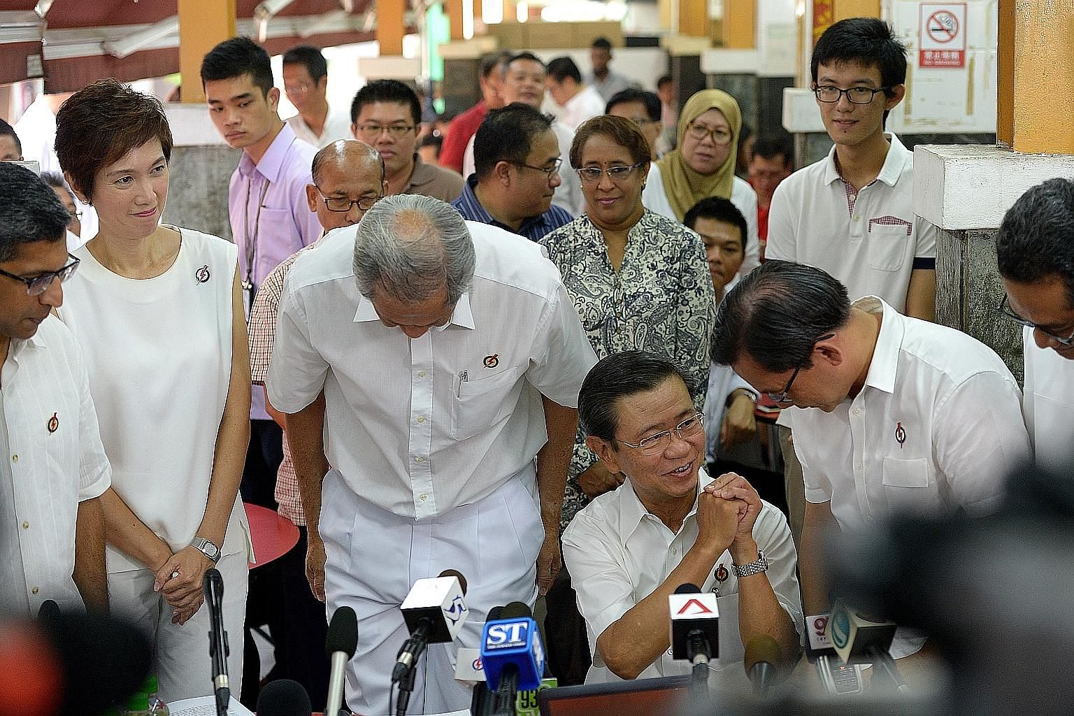 Mr Wong Kan Seng's PAP colleagues stood up and bowed to thank him for his contributions, including (from left) Mr Hri Kumar Nair, Mrs Josephine Teo, Dr Ng Eng Hen, Mr Chong Kee Hiong and Mr Zainudin Nordin.