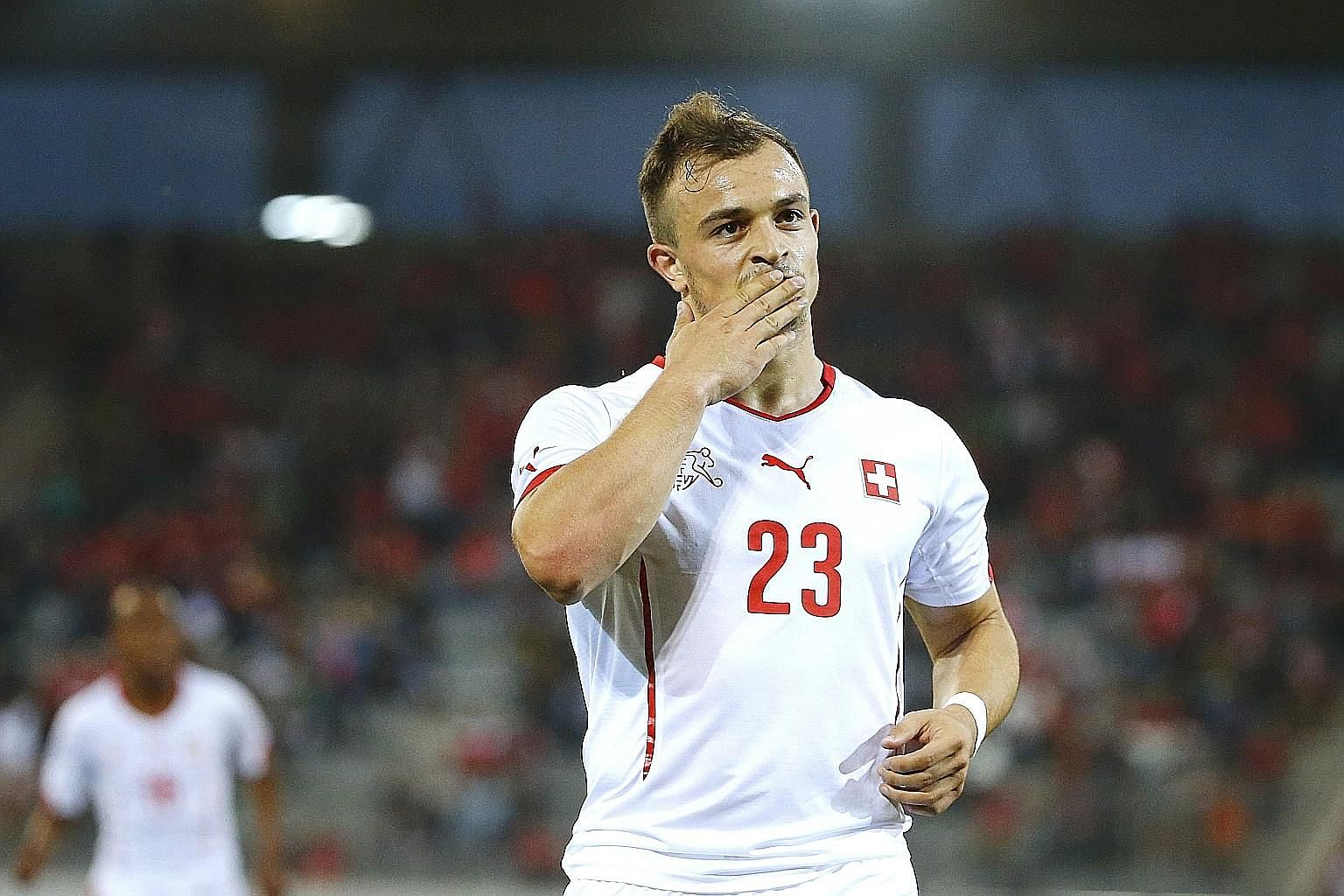 Swiss player Xherdan Shaqiri joins Stoke for £12 million, as mid-tier clubs also spend big.