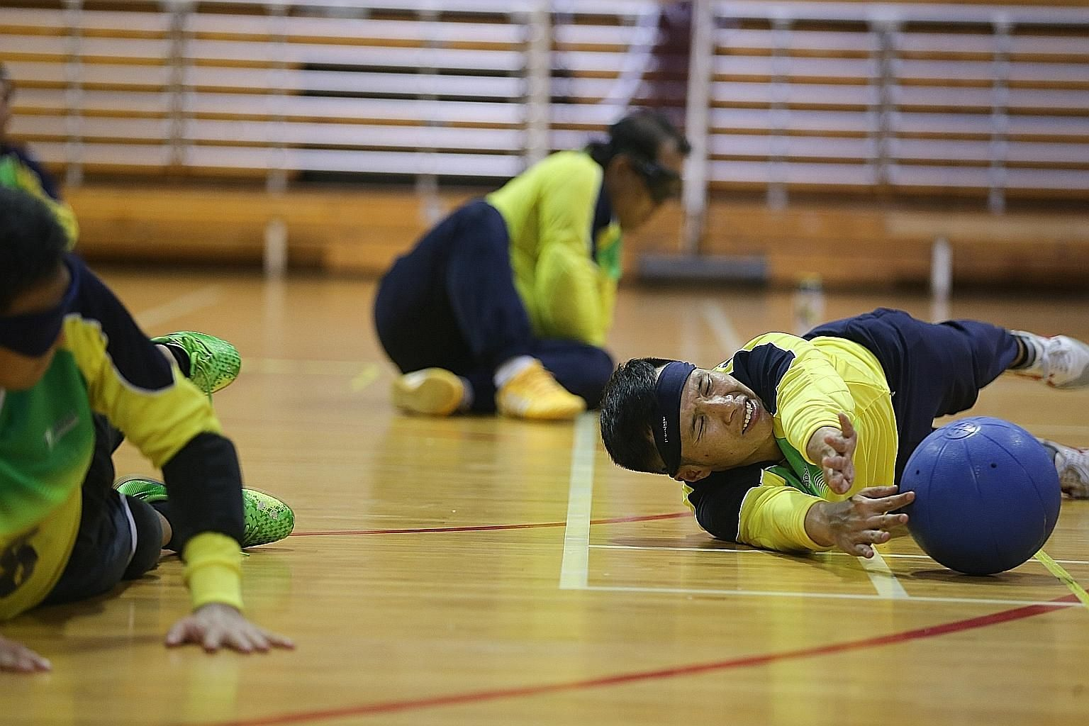 Kelvin Tan (foreground) at a training session for goalball. This team sport for blind athletes will be included in the Asean Para Games in Singapore from Dec 3-9.
