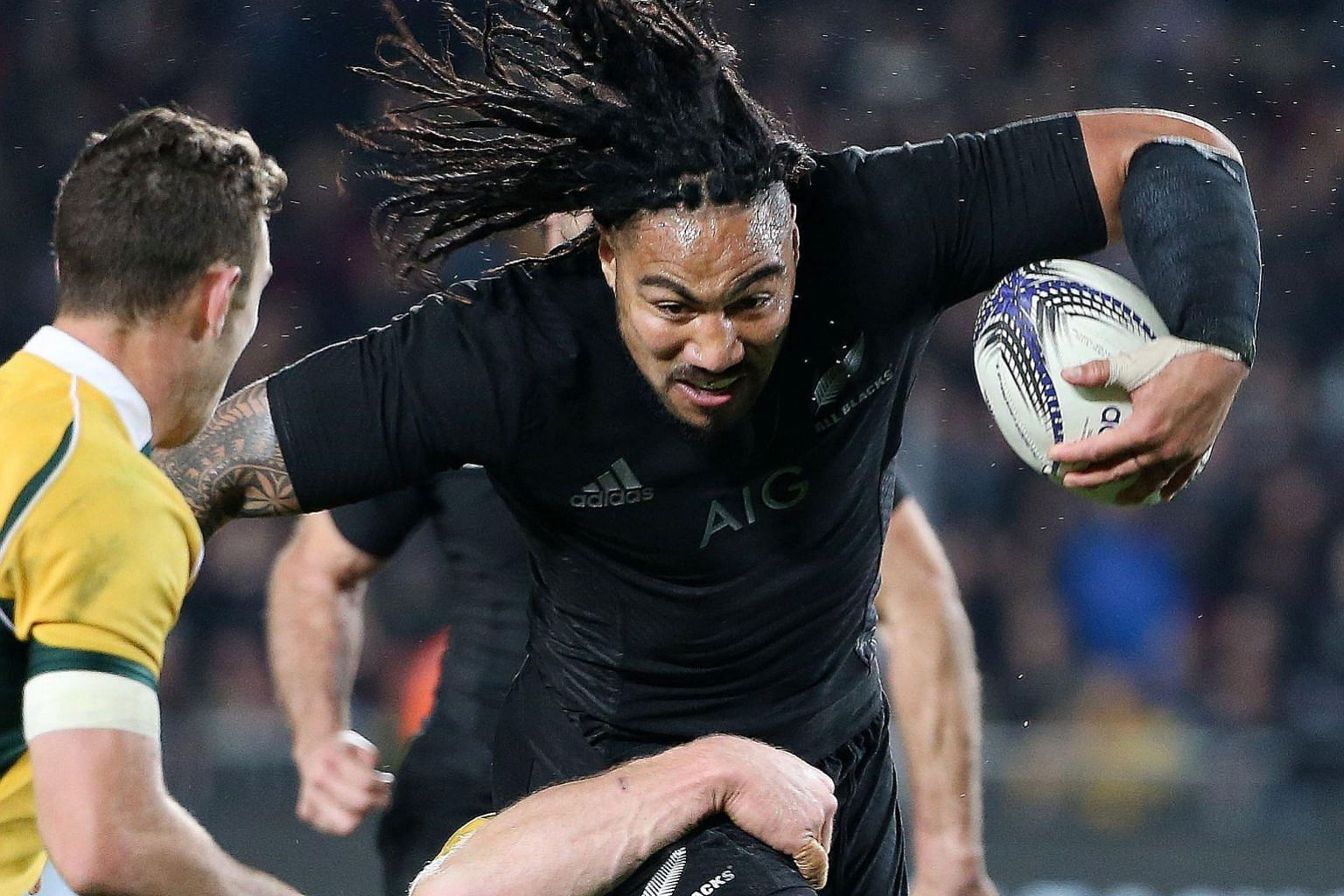 Ma'a Nonu of New Zealand scores a try during the 41-13 victory against Australia in the Bledisloe Cup match in Auckland yesterday.