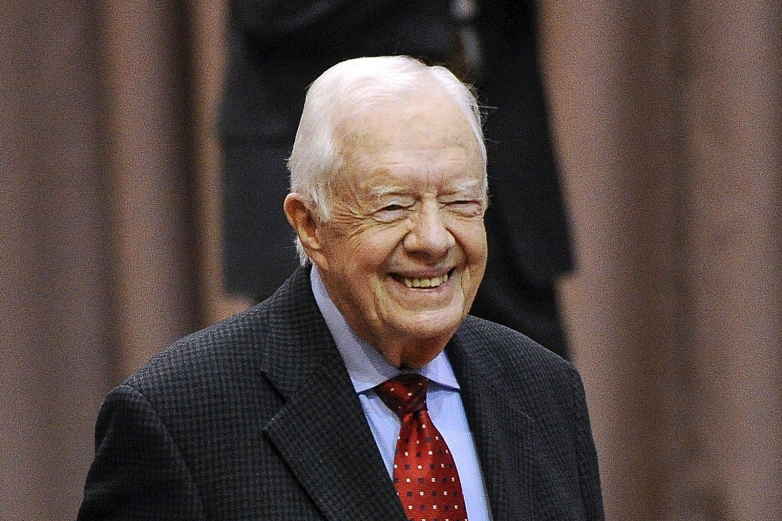 Former US president Jimmy Carter arriving for a news conference in Atlanta to discuss his cancer diagnosis and treatment on Thursday.