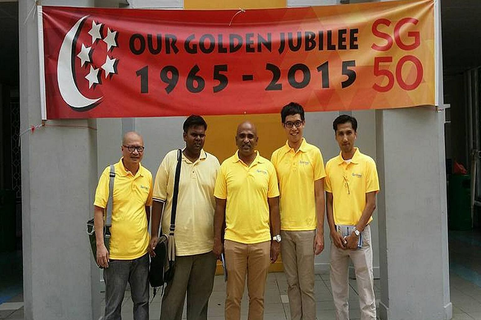(From left) Mr Gilbert Ong, Mr Siva Chandran, Mr M. Ravi, Mr Roy Ngerng and Mr Osman Sulaiman wearing Reform Party T-shirts during their walkabout in Ang Mo Kio on Sunday. Mr Osman is likely to spearhead the party's Ang Mo Kio GRC team.