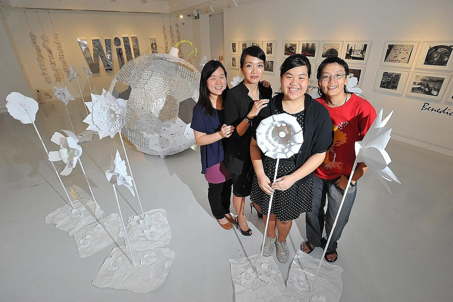 Eco-artist Rene Ong (in red), in her 40s, worked with four patients, one of whom was student Summer Tham (in polka-dot outfit), 16, to produce The Life Within Transcends The Ticking Time Bomb (in the background). With them are project coordinators Lo