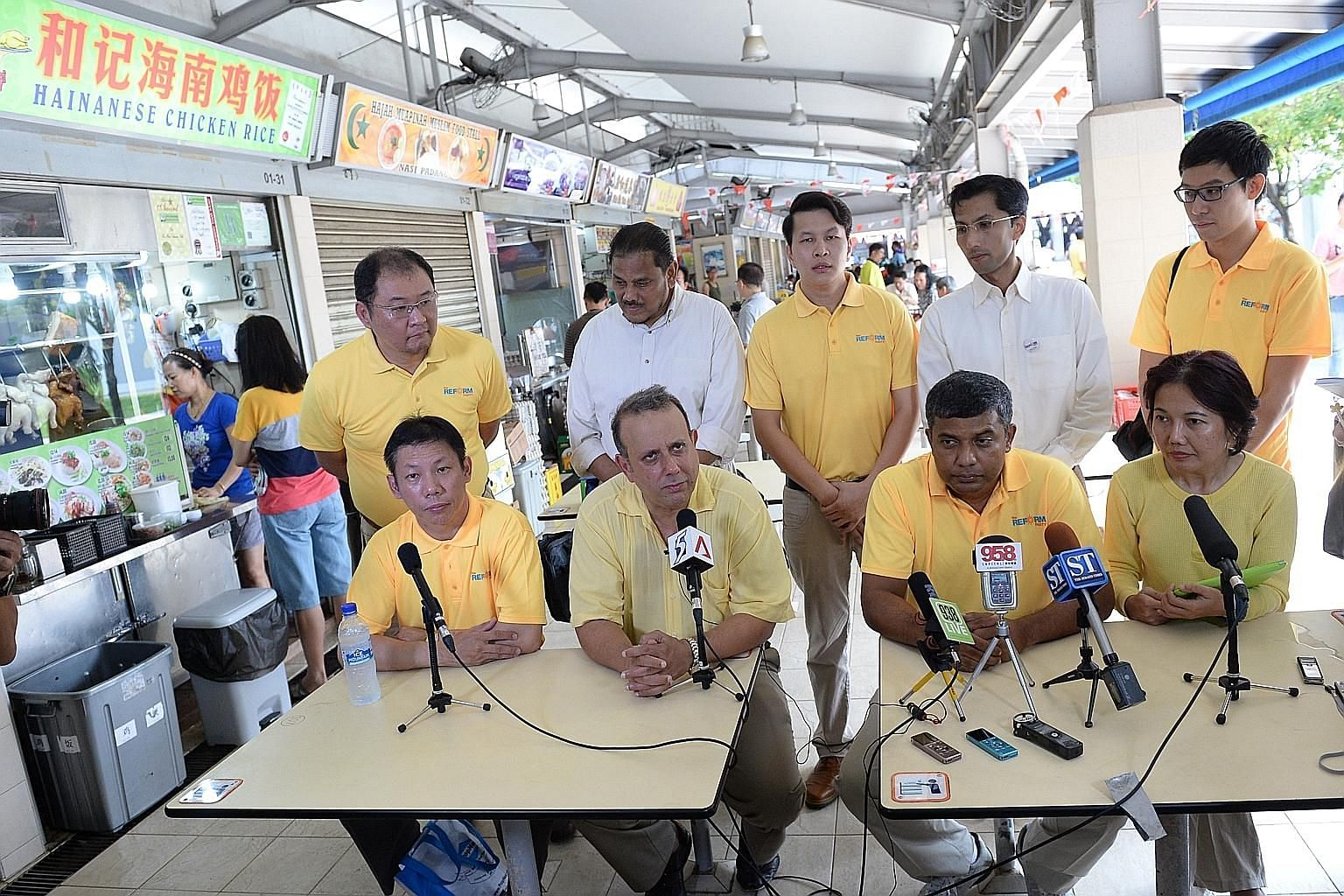 The Reform Party yesterday unveiled its first batch of candidates at a hawker centre in Telok Blangah. Contesting West Coast GRC are (seated, from left) property agent Darren Soh and RP secretary-general Kenneth Jeyaretnam; RP chairman Andy Zhu (stan