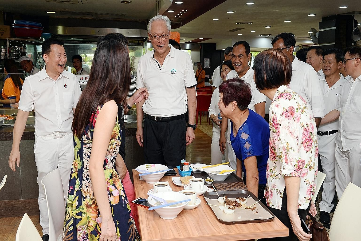 Emeritus Senior Minister Goh Chok Tong on a walkabout in Aljunied GRC with PAP candidates Victor Lye (far left) and Shamsul Kamar (to Mr Goh's left), who will both be running in the constituency. There are 24 new faces in the PAP's slate for this yea