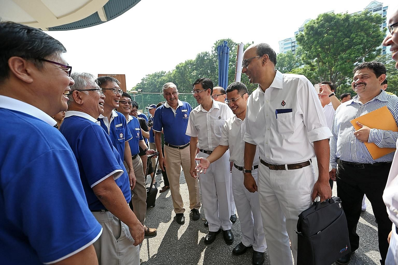 SingFirst candidates for Jurong GRC (from left) Mr Wong Soon Hong, Mr Tan Peng Ann, Mr Wong Chee Wai, Mr David Foo and Mr Sukdeu Singh meeting three members of the PAP team at the nomination centre yesterday. They are (in white, from right) Deputy Pr