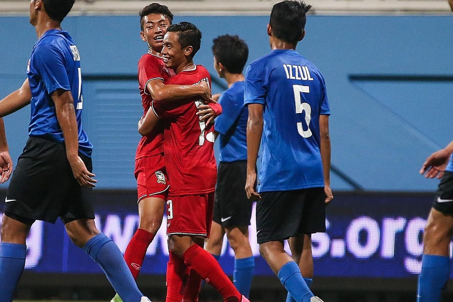 Thai players (in red) celebrating another goal during their 5-0 victory over Singapore in their AFC U-16 Championship qualifier at Jalan Besar Stadium.