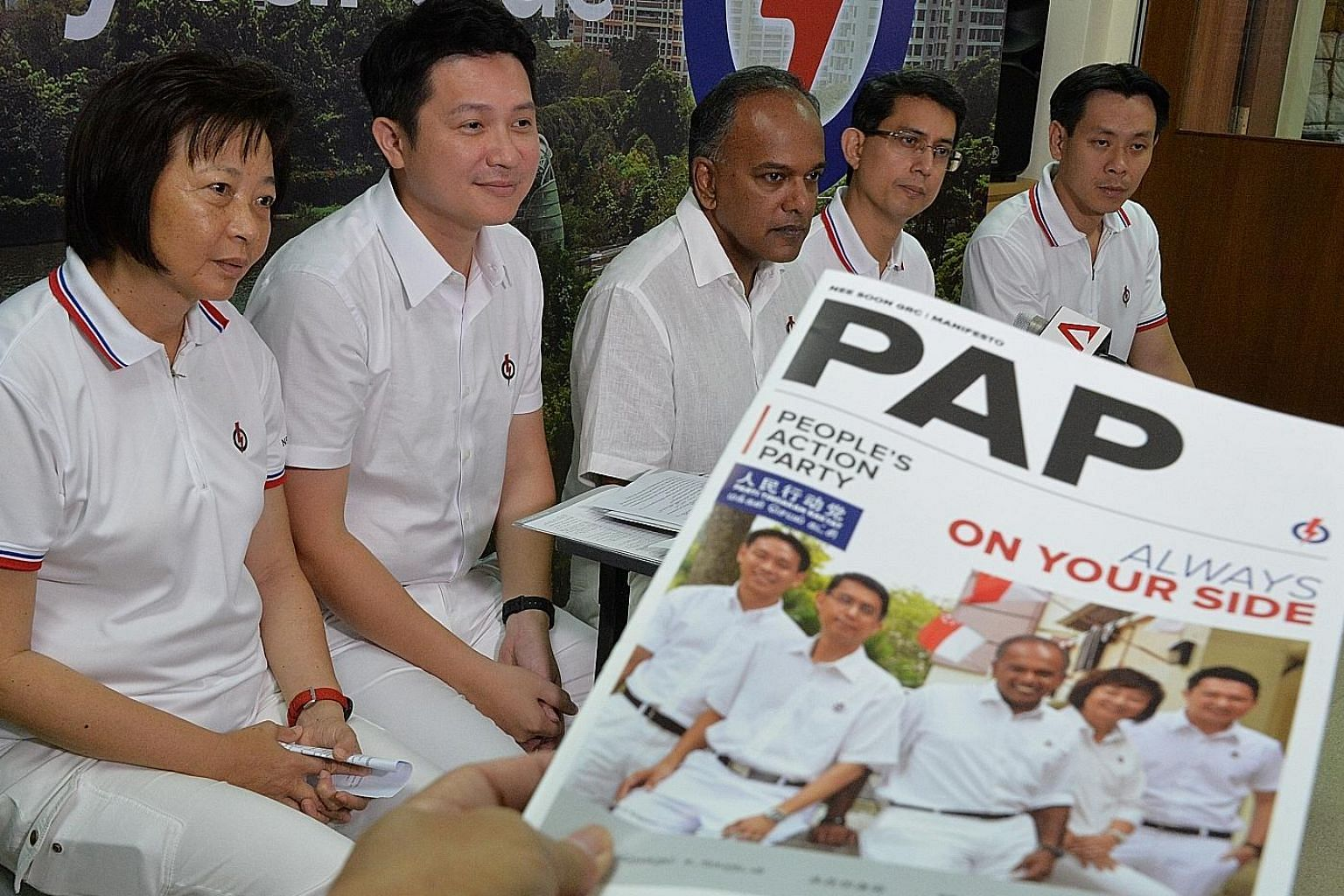 PAP's Nee Soon GRC candidates (from left) Lee Bee Wah, Henry Kwek, K. Shanmugam, Muhammad Faishal Ibrahim and Louis Ng at a press conference to unveil their local manifesto.