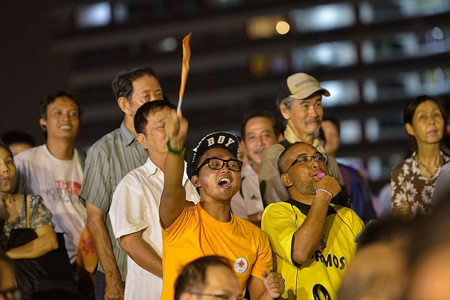 Spectators at the National Solidarity Party rally in Tampines last Saturday. The writer met various folks there, from rally-hoppers to dyed-in-the-wool opposition supporters.