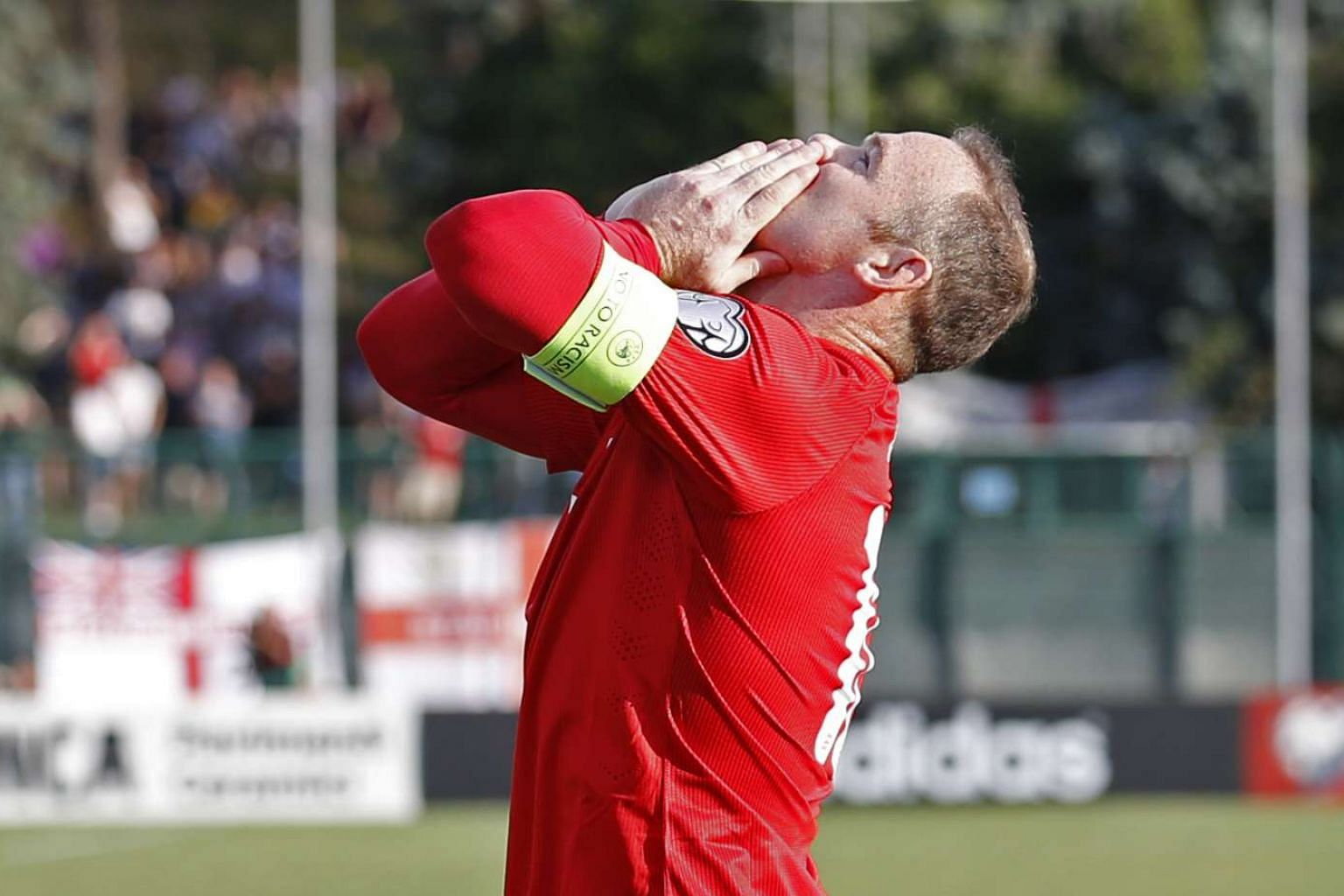 Wayne Rooney celebrates his penalty against San Marino on Saturday that enabled him to draw level with Bobby Charlton's tally.