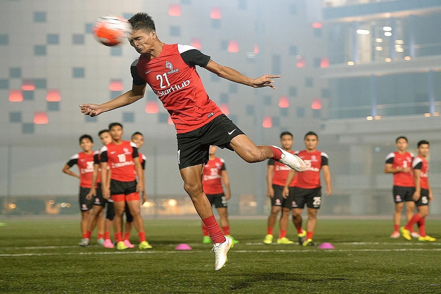 Safuwan Baharudin heading a ball during a LionsXII training session at ITE College Central in Ang Mo Kio yesterday.