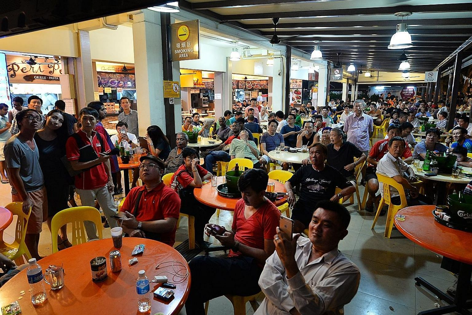 Clockwise from left: People in a Potong Pasir coffee shop watching the poll results on TV last night; Mr Sitoh Yih Pin talking to reporters before the results; Mrs Lina Chiam left after the sample count showed her opponent clearly in the lead.