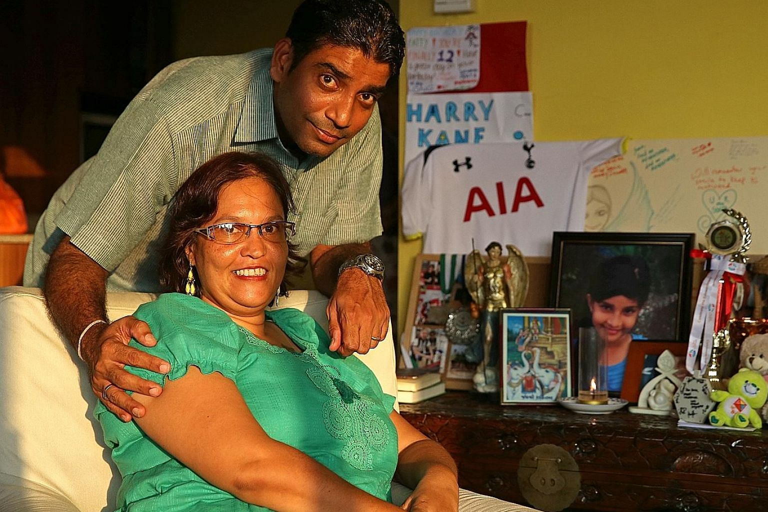 Mr Jaidipsinh Jhala and wife Karen with photos, trophies and other items belonging to daughter Sonia, one of seven pupils who died.