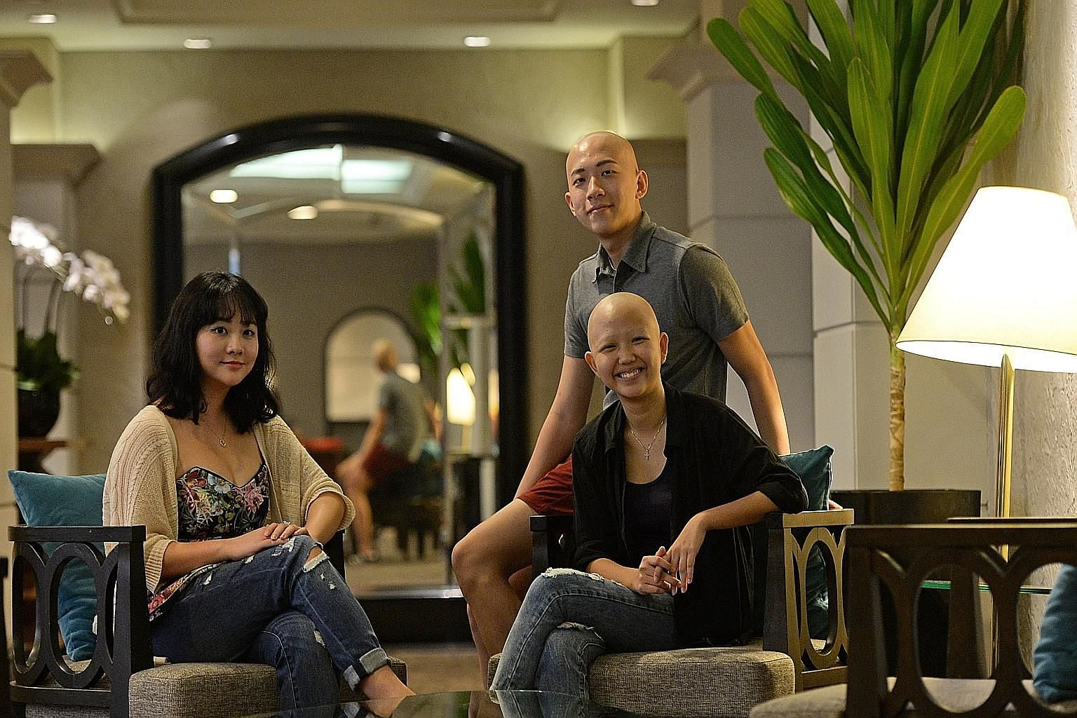 Ms Chan See Ting (seated right), reached out to fellow sufferers of alopecia areata in a Facebook post last month. Some members of the support group met yesterday for the first time, including Mr Kenneth Goh and Ms Tay Zhi Yun.
