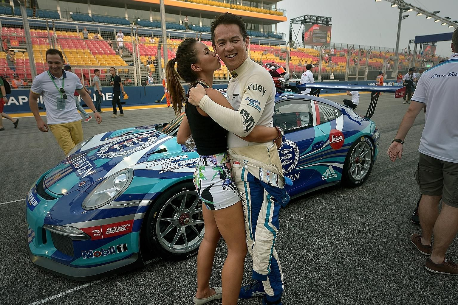 """Yuey Tan with his fiancee, Claire Jedrek, yesterday. """"I have to push harder, I have to go for broke,"""" he said."""