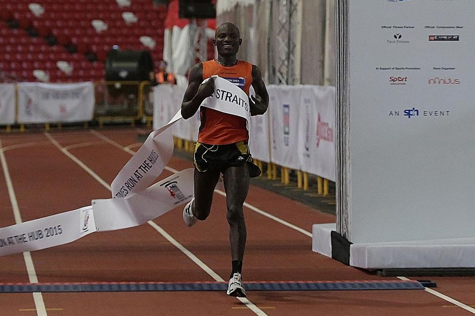 Kenyan David Kibet crossing the finish line for the men's 18.45km race at the National Stadium yesterday. This was the 27-year-old's first race in Singapore.
