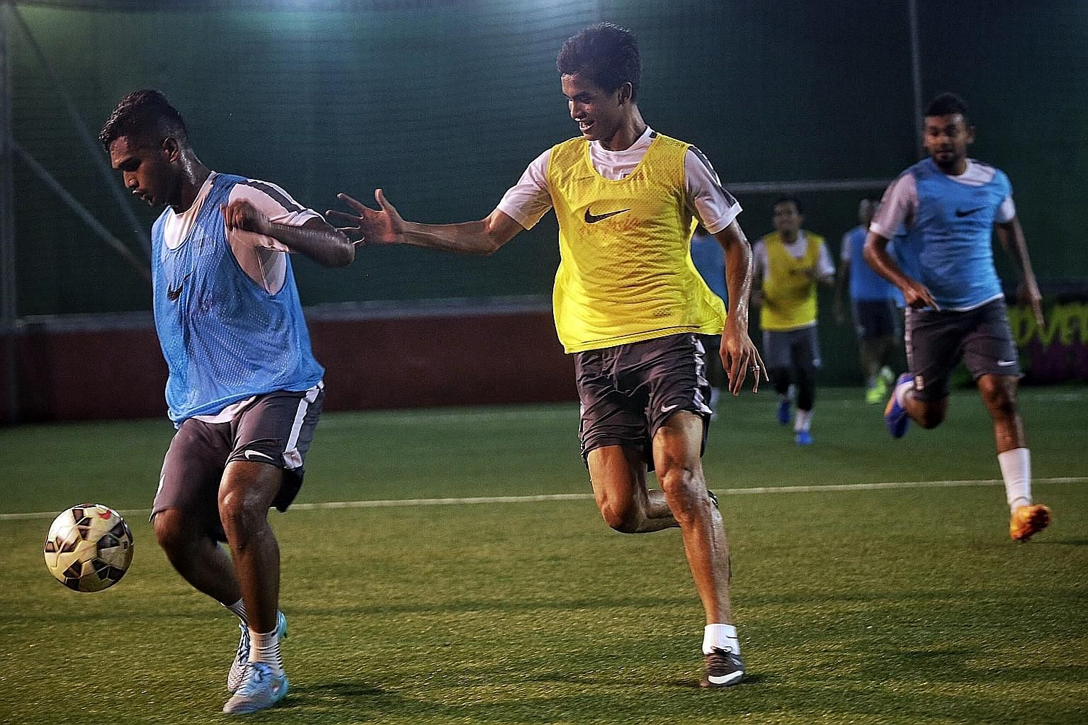 Safuwan Baharudin chases Hariss Harun for the ball during a futsal training match in Amara Hotel. The two key players will be available for the tie against Cambodia on Tuesday.
