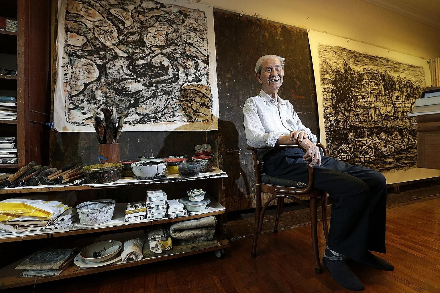 Artist Lim Tze Peng with some of his works in his home studio.