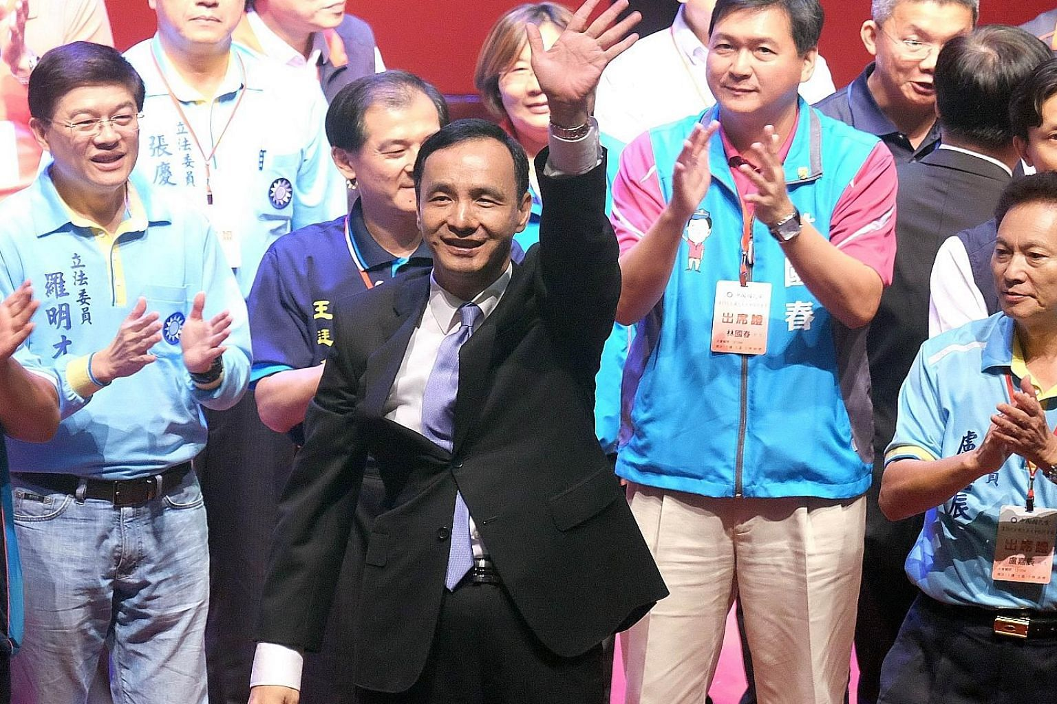 Mr Eric Chu (centre), chairman of Taiwan's ruling Kuomintang, waving after being nominated as the party's presidential candidate yesterday, replacing Ms Hung Hsiu-chu, who was unceremoniously ousted after she failed to win over the public ahead of th