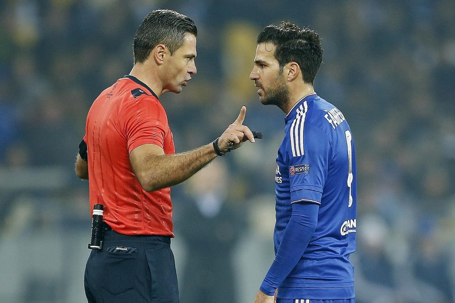 Chelsea's Cesc Fabregas speaks to referee Damir Skomina after being denied a penalty. Chelsea are in third place in Champions League Group G after their 0-0 draw.