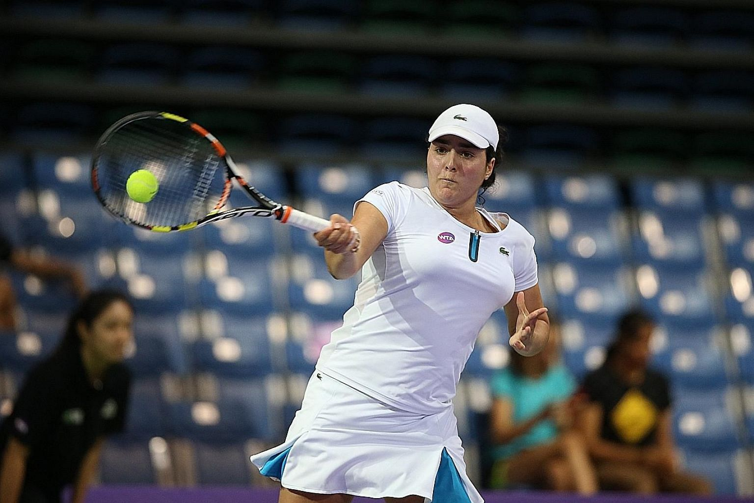 Ons Jabeur of Tunisia hitting a forehand yesterday in her match against Japan's Naomi Osaka at the OCBC Arena. Jabeur, 21, won the match 2-4, 5-4, 4-1 for her first win of the WTA Rising Stars Invitational tournament. France's Caroline Garcia made it