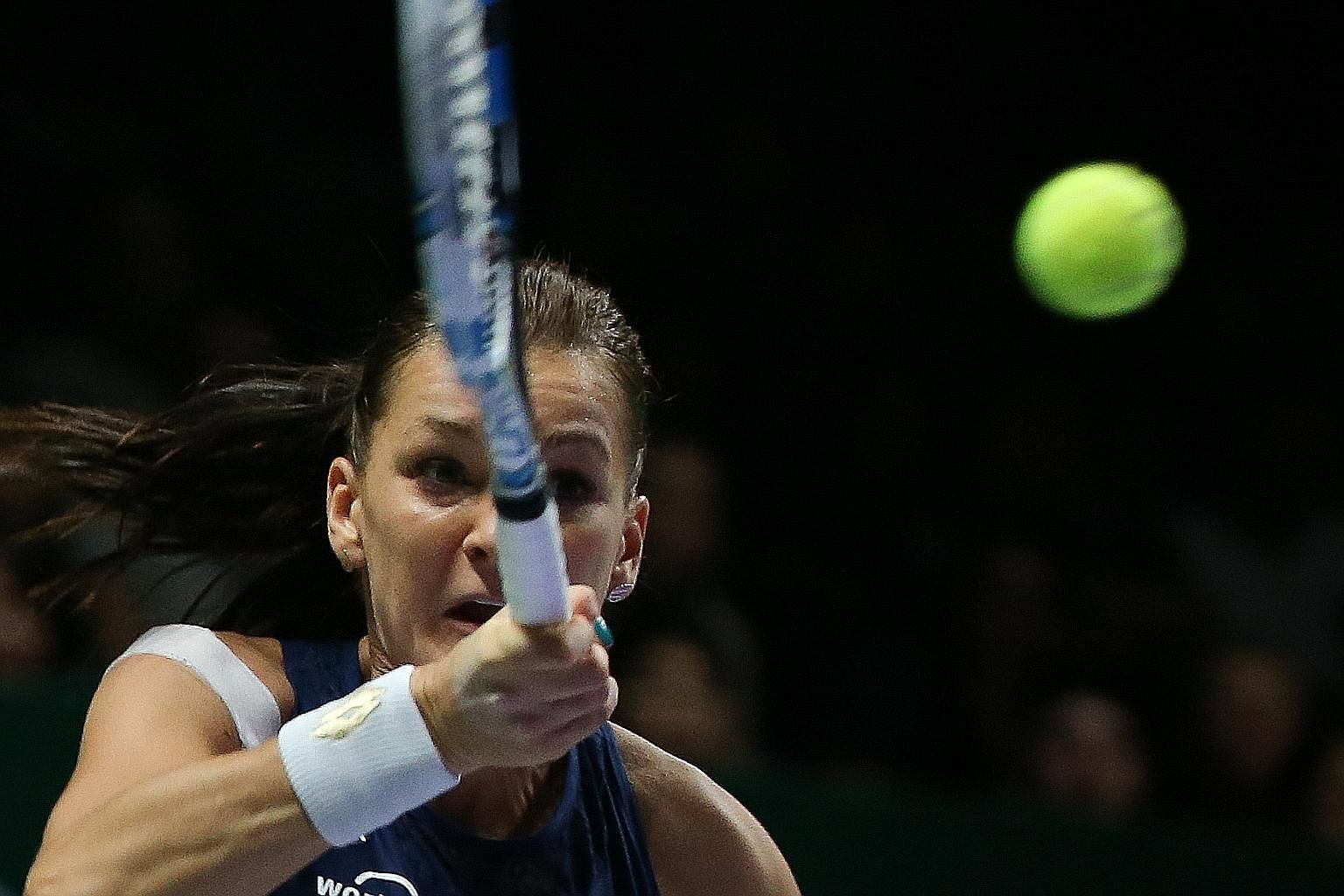 Petra Kvitova taking it out on her racquet after losing a point. Poland's Agnieszka Radwanska is the new year-end world No. 5 after beating the Czech Petra Kvitova 6-2, 4-6, 6-3 to win the WTA Finals title at the Singapore Indoor Stadium.