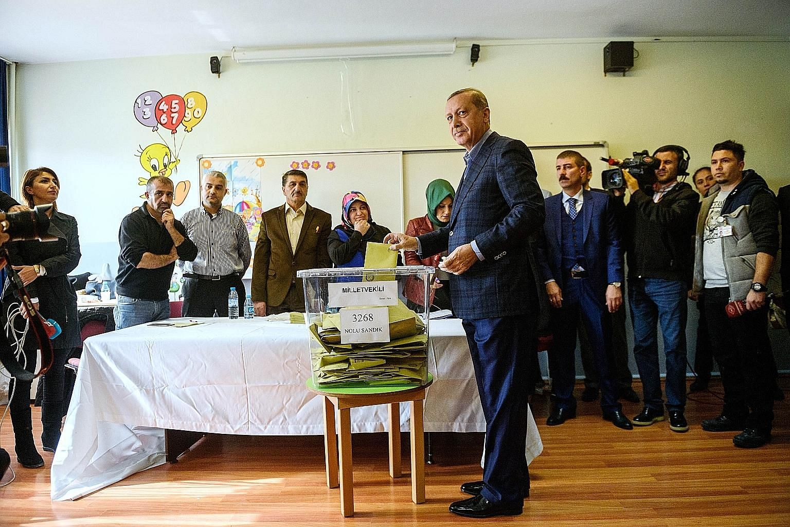 President Recep Tayyip Erdogan casting his ballot in Istanbul. Yesterday's election is one of Turkey's most crucial elections in years, with the country deeply divided in the face of surging Kurdish and Islamic violence and concerns about democracy a