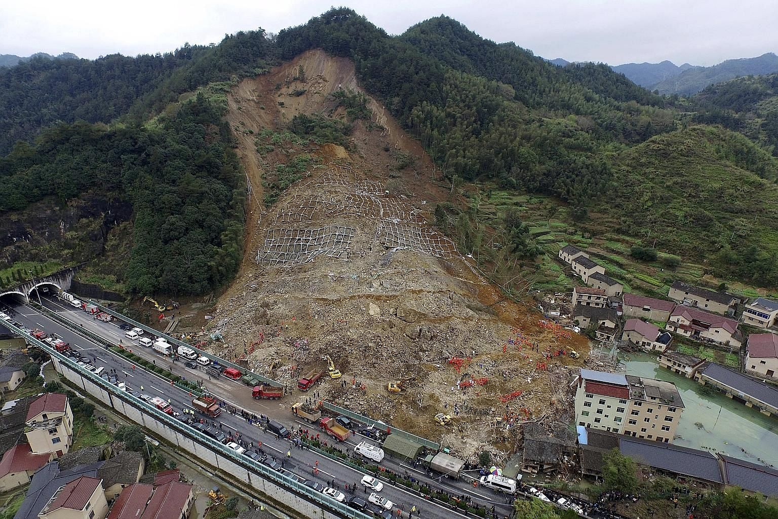 An aerial view of rescuers searching for survivors at the site of a landslide in China's Zhejiang province. Only one person has been rescued so far in the disaster which struck last Friday. The death toll stands at 25, with 12 people missing.