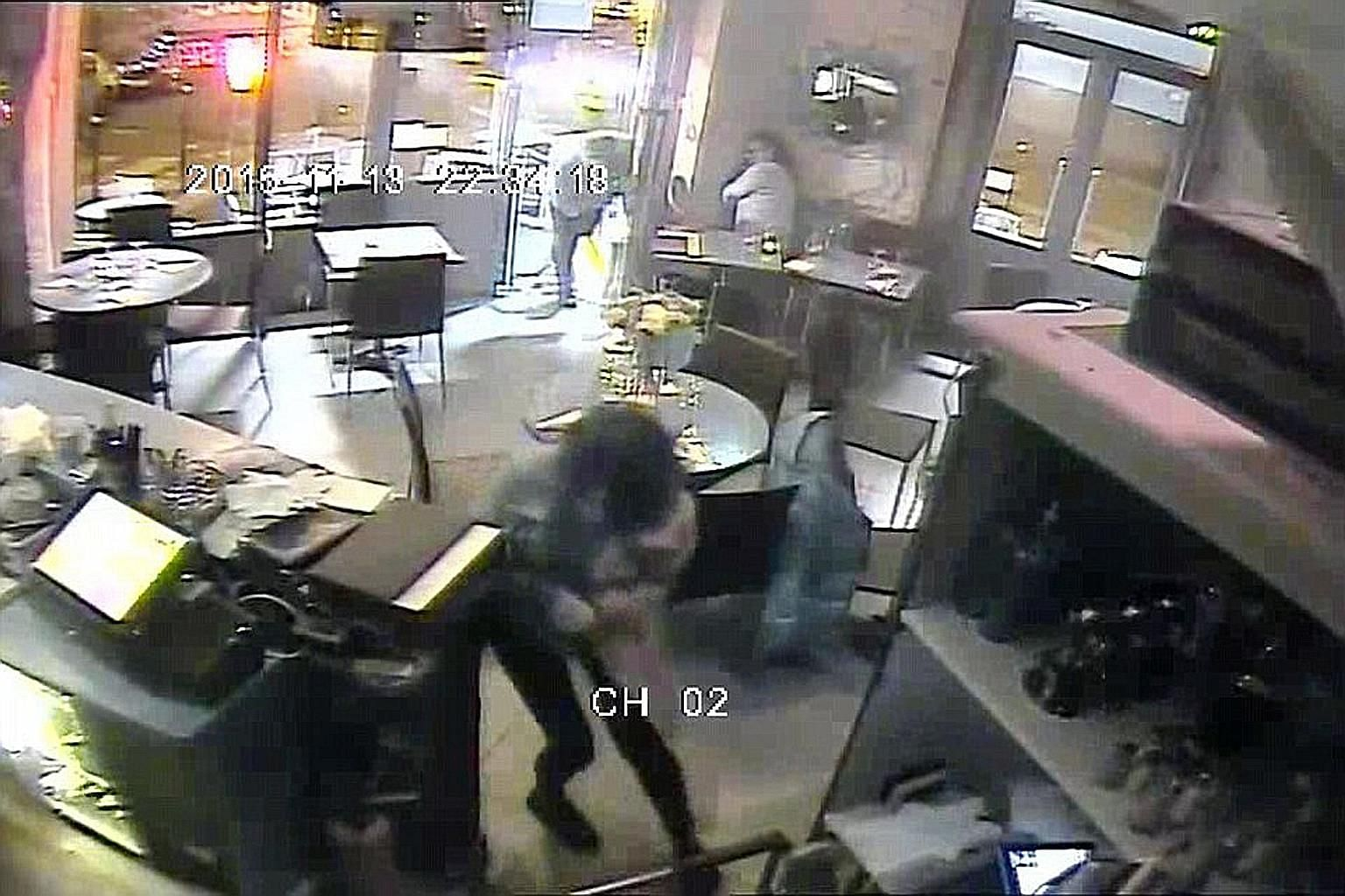 An image from the video released by the Daily Mail that shows people fleeing as bullets fly. The paper is alleged to have paid €50,000 for the footage, captured by CCTV cameras at Paris' Casa Nostra pizzeria.