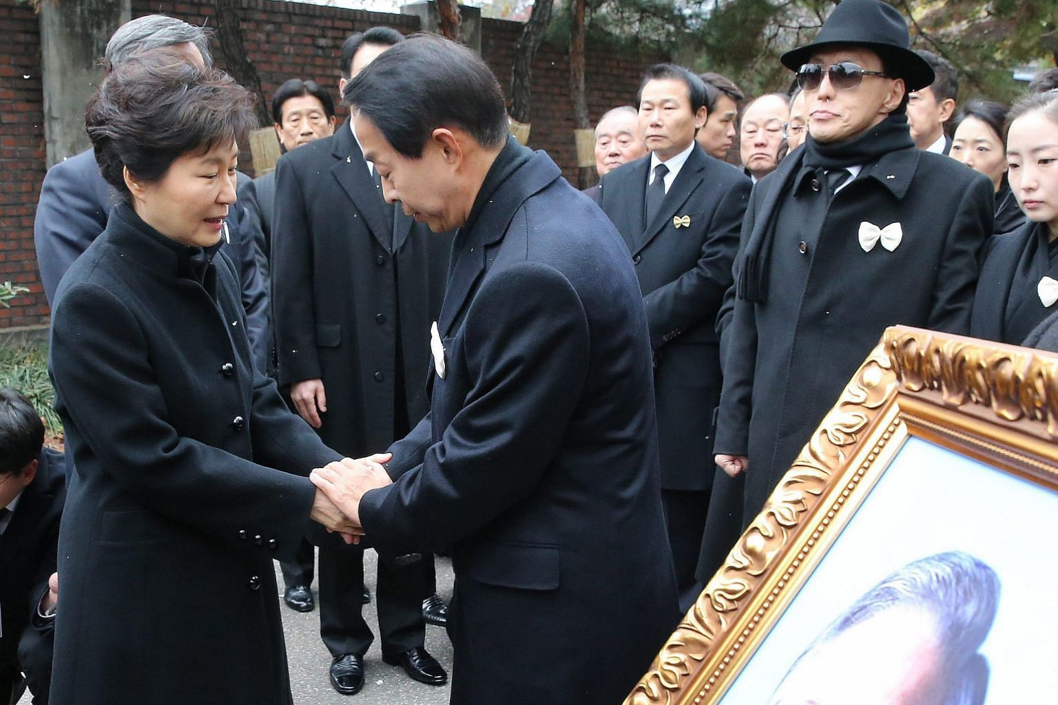 South Korean President Park Geun Hye comforting Mr Kim Hyun Chul, son of late former president Kim Young Sam, who died on Sunday after a blood infection.
