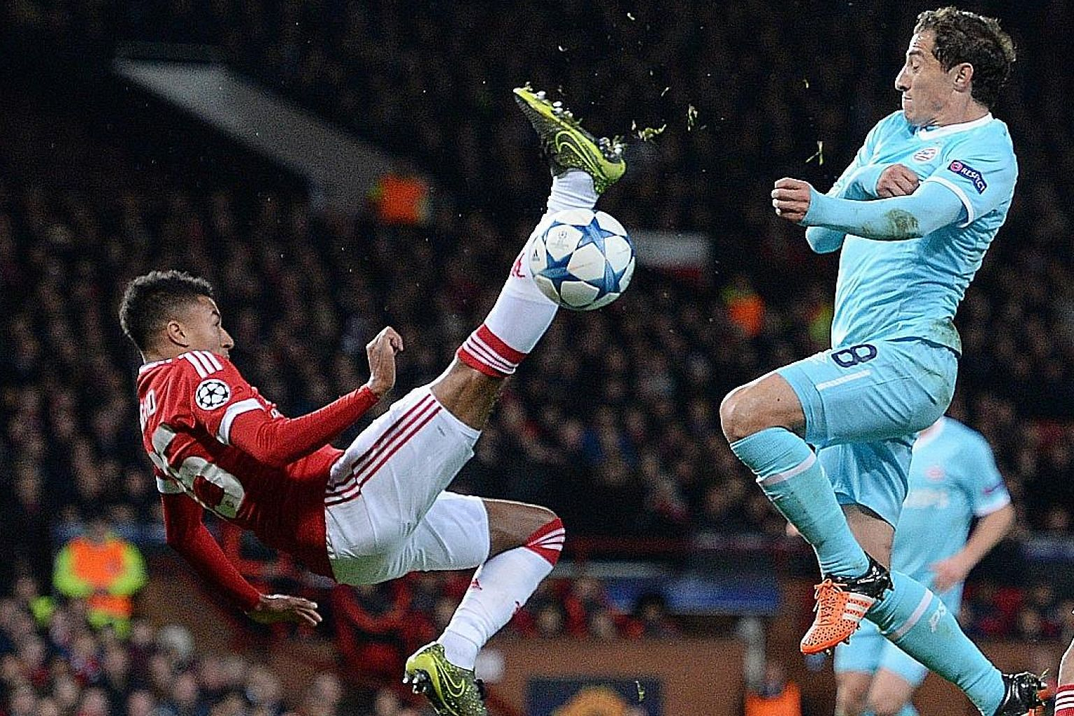 There were few clear-cut chances to score, with this overhead kick from Jesse Lingard (left) failing to find the net against PSV Eindhoven. The 0-0 draw at Old Trafford was greeted by boos from the exasperated crowd.