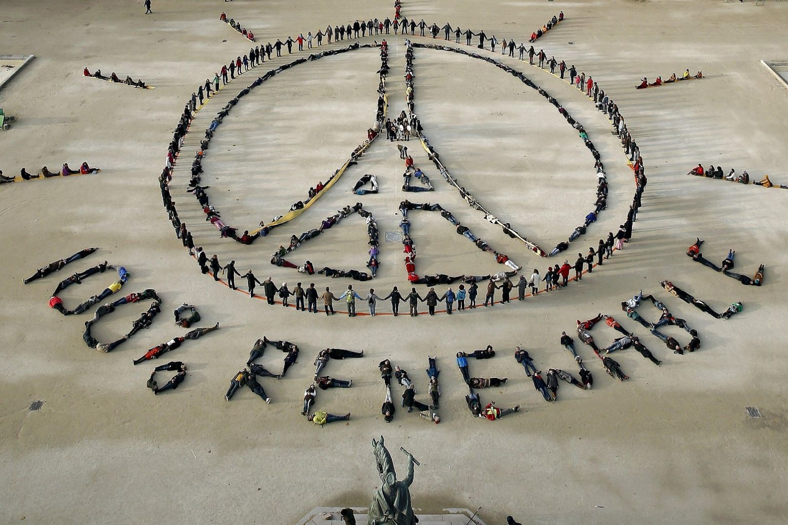 Environment activists forming a message of peace in front of the Eiffel Tower in Paris on Sunday as the World Climate Change Conference took place in the city. The writer says one of the great challenges in the push to save the planet is that climate