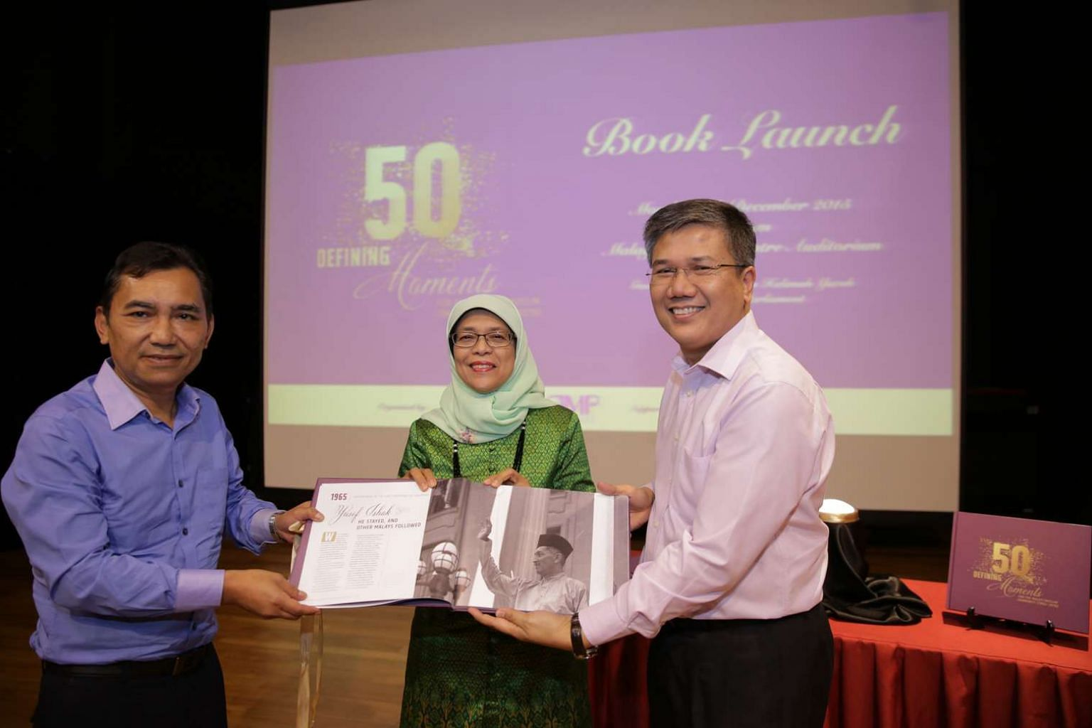 (From left) Berita Harian editor Mohd Saat Abdul Rahman, Speaker of Parliament Halimah Yacob and AMP chairman Azmoon Ahmad at the launch of the book, 50 Defining Moments For The Malay/Muslim Community, at the Malay Heritage Centre yesterday.
