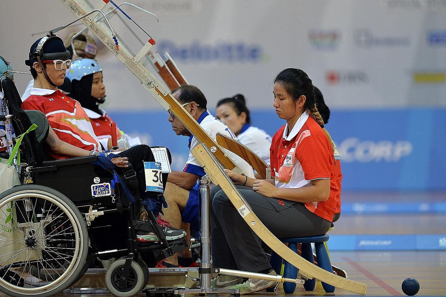 Toh Sze Ning (front) and Nurulasyiqah Mohammad Taha had to settle for silver after losing to Thailand's Tanimpat Visaratanunta and Ekkarat Chaemchoi in the boccia BC3 mixed pair category yesterday.