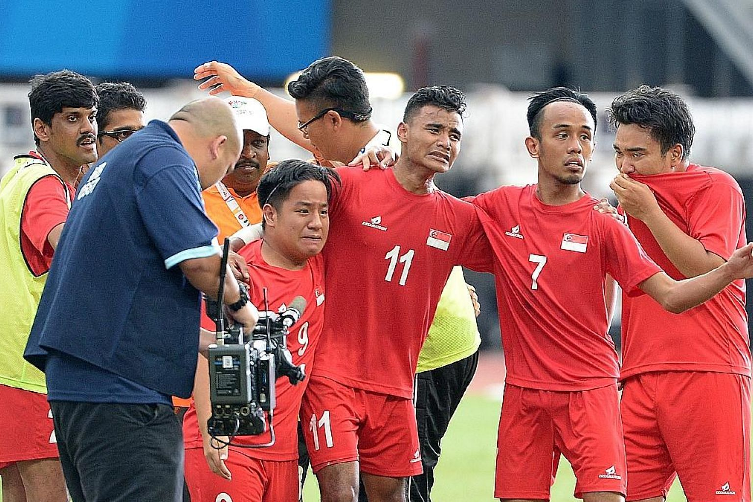 An emotional Muhammad Mubarak (No. 11), who scored the winner, celebrating with members of the Singapore celebral palsy football team after beating Malaysia 2-1 to win the bronze.