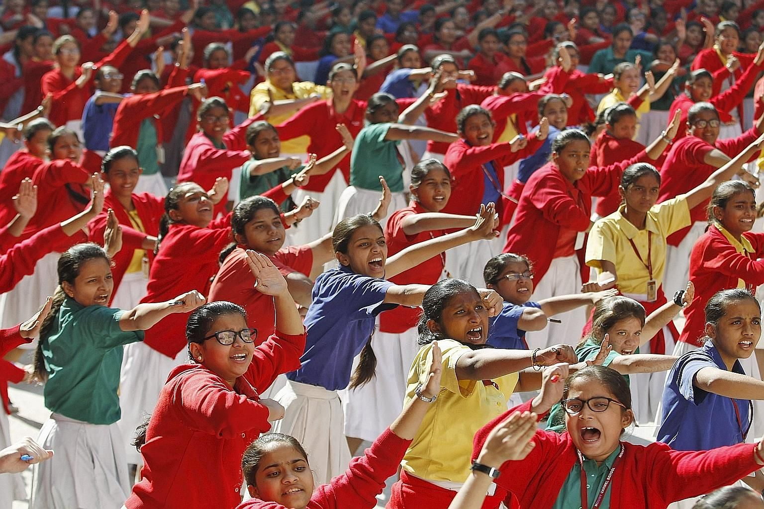 Schoolgirls practising martial arts during an event in Ahmedabad, India, on Wednesday to mark the third anniversary of the fatal gang rape of a woman on a Delhi bus in December 2012.
