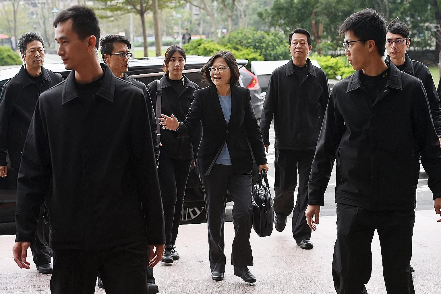 President-elect Tsai Ing-wen arriving at the DPP headquarters in Taipei yesterday, following the party's victory in last Saturday's presidential and parliamentary elections. The new DPP-majority legislature will be sworn in on Feb 1, but with a KMT p