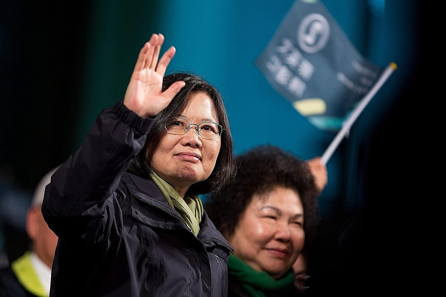 Ms Tsai waving to supporters after winning the presidential election last Saturday. She is the first woman without political lineage in Asia to head a government.