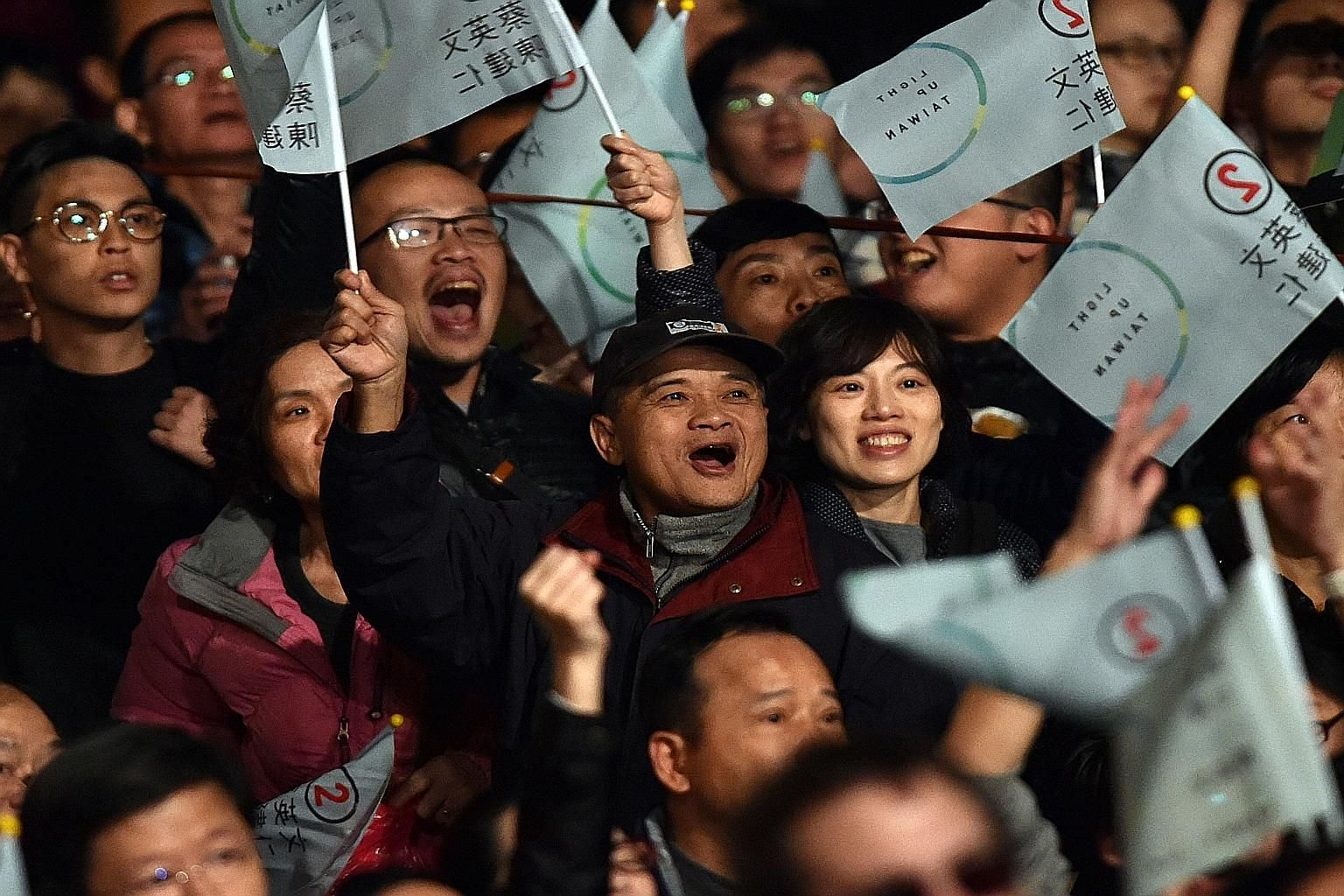 Ms Tsai's supporters cheering after her landslide win against the Kuomintang last weekend. A Tsai-led Taiwan is likely to persist with existing institutional mechanisms to pursue cross-strait relations with China, although the frequency or pace of ex