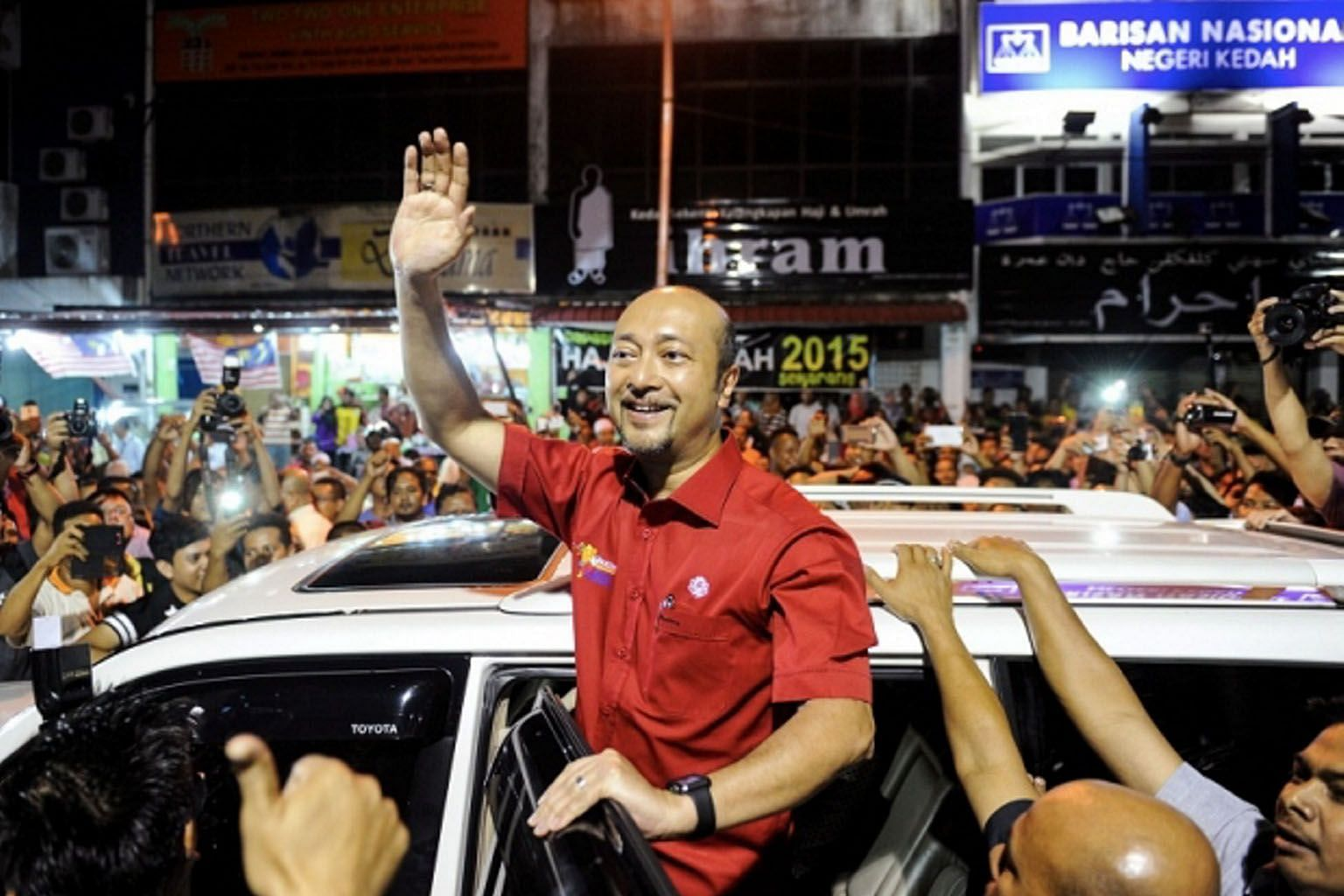 Mr Mukhriz being greeted by supporters at the Kedah Umno headquarters last month. The question now is not whether he will quit, but when he will go. He is adamant about staying on, saying the people are with him.