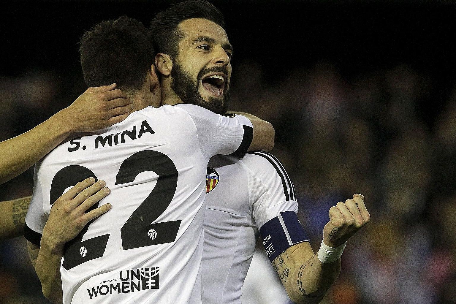 The clenched fist of Valencia's Alvaro Negredo speaks volumes as he embraces team-mate Santi Mina during the 6-0 rout of Rapid Vienna in their Europa League clash. The win further eased the pressure on Gary Neville, who turned 41 that day.