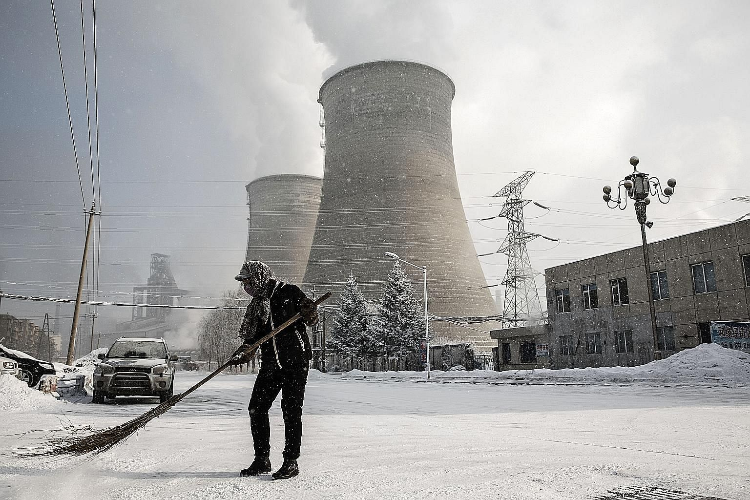 The cooling towers of a steel plant in Tonghua, Jilin province. The Chinese city's once-vaunted state-run steel mills have slipped inexorably into decline, weighed down by slumping global markets, a changing economy and the burden of costs and respon