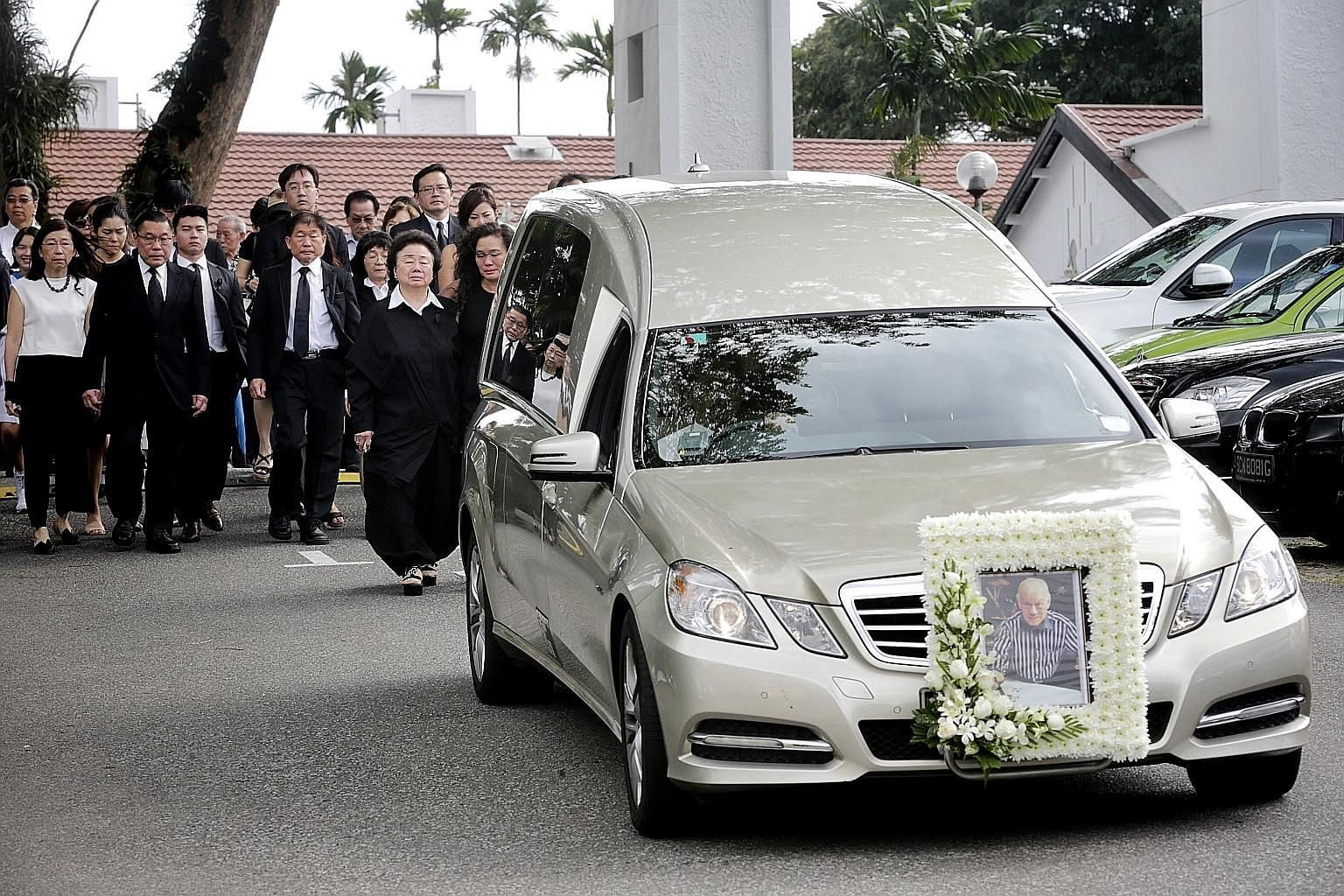 The cortege leaving Mount Vernon Sanctuary for Mandai Crematorium, after the funeral service for the late Mr Lee Khoon Choy yesterday. Mr Lee leaves behind his wife, seven children and 11 grandchildren.