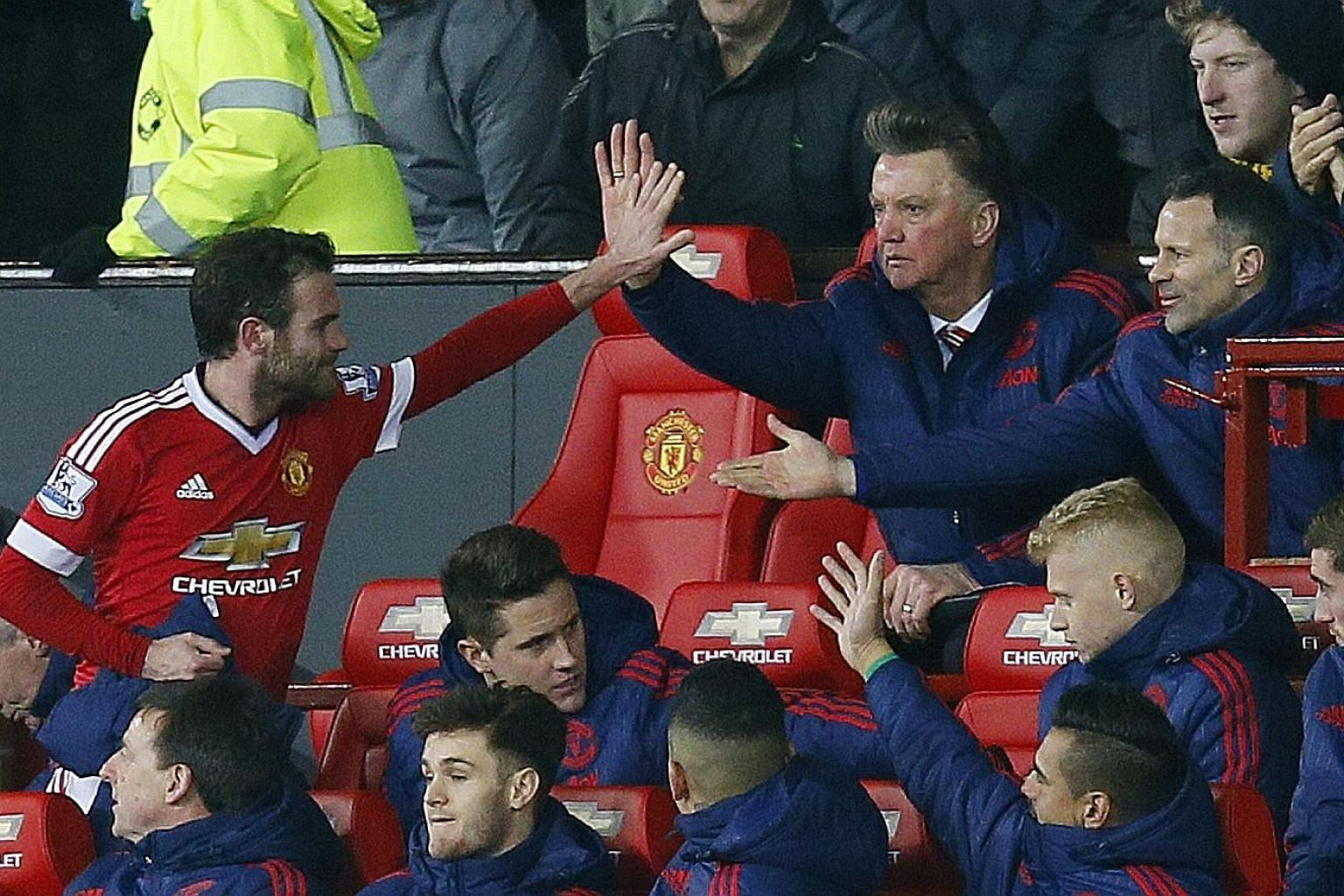 Manchester United's Juan Mata (far left) celebrating with Louis van Gaal and Ryan Giggs after being substituted in the 1-0 win over Watford, where he scored the winner.
