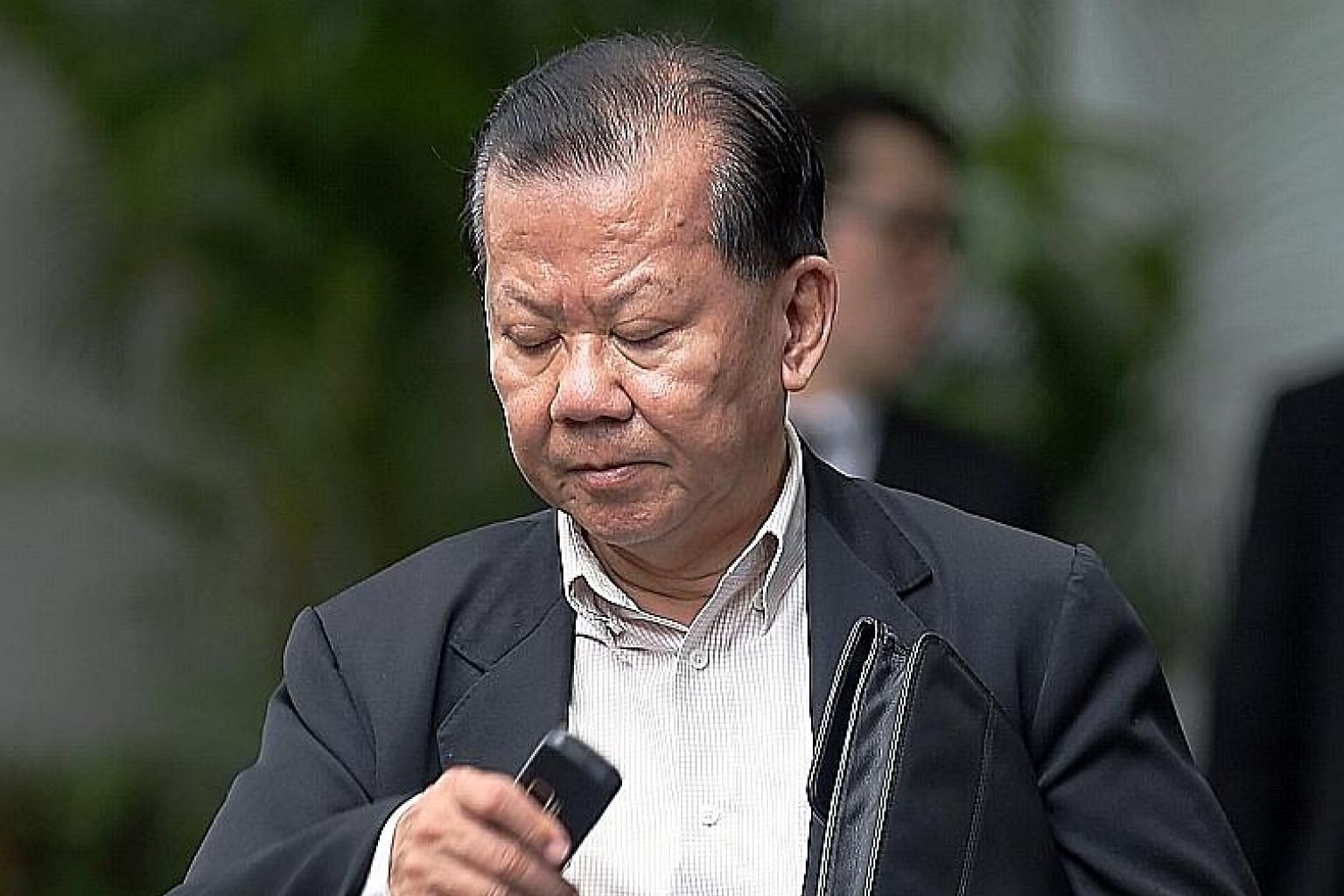 Wong Kok Keong invited three shareholders of Manor Construction to invest in a project and also duped them into agreeing to buy shares in a company. He encashed the cheques they gave him,